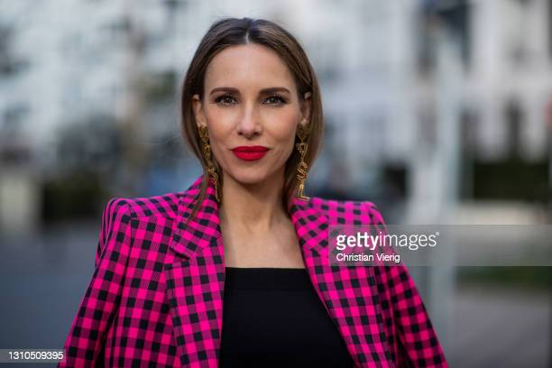 Alexandra Lapp is seen wearing BALENCIAGA checked Hourglass blazer in pink and black, ALEXANDER MCQUEEN off-shoulder knitted top in black, look by...