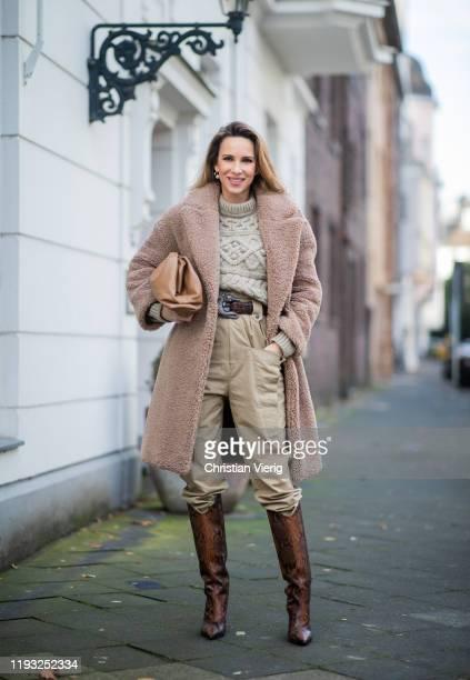 Alexandra Lapp is seen wearing beige Isabel Marant pants and knit, brown belt Kieselstein, brown Jimmy Choo boots with snake print, brown Bottega...