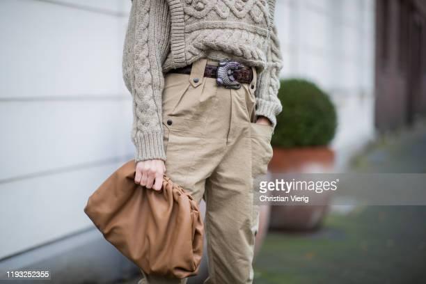 Alexandra Lapp is seen wearing beige Isabel Marant pants and knit brown belt Kieselstein brown Bottega Veneta Pouch bag on December 10 2019 in...