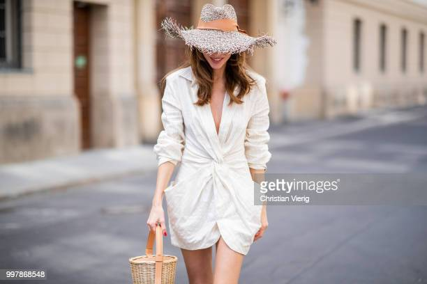 Alexandra Lapp is seen wearing beige striped La Robe Bolso dress by Jacquemus, Maureen leather mules in leo print from Malone Soulless, L'osier sand...
