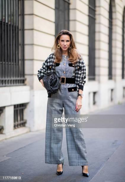 Alexandra Lapp is seen wearing black and white Gucci jacket, checkered Gucci jumpsuit, black intrecciato Bottega Veneta The Pouch clutch and Gianvito...