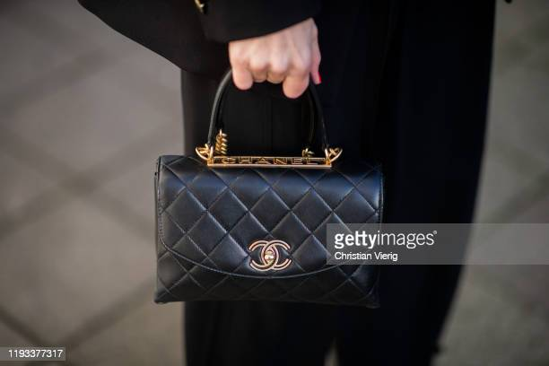 Alexandra Lapp is seen wearing black Chanel flap bag with top handle in lambskin and & gold tone metal, red vintage toddler earrings Chanel on...