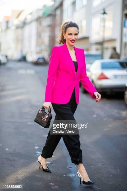 Alexandra Lapp is seen wearing black high waist Givenchy pants, Dior bra top, black J'Adior slingback pumps Dior and Lady Dior mini bag, pink...