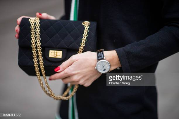 Alexandra Lapp is seen wearing Brax college knit cardigan, IWC watch, 2.55 jersey flap bag from Chanel during the Berlin Fashion Week Autumn/Winter...