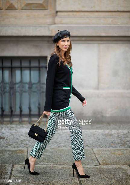 Alexandra Lapp is seen wearing Brax college knit cardigan printed pants from Brax Christian Louboutin patent leather stiletto pumps Illesteva cateye...