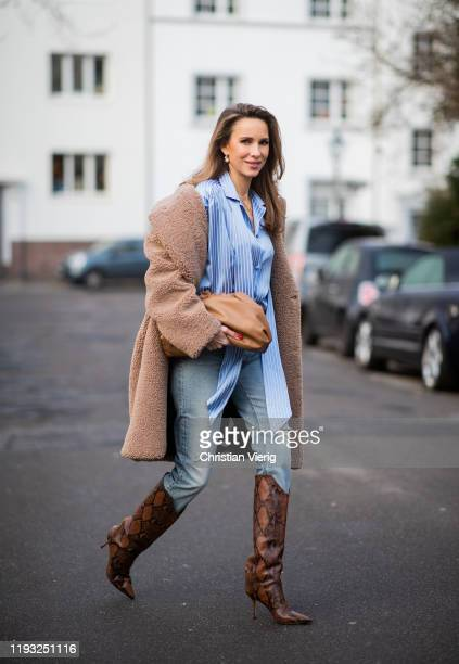 Alexandra Lapp is seen wearing brown Zara teddy coat oversized blue striped button shirt Balenciaga brown Gucci belt light blue ripped denim jeans...