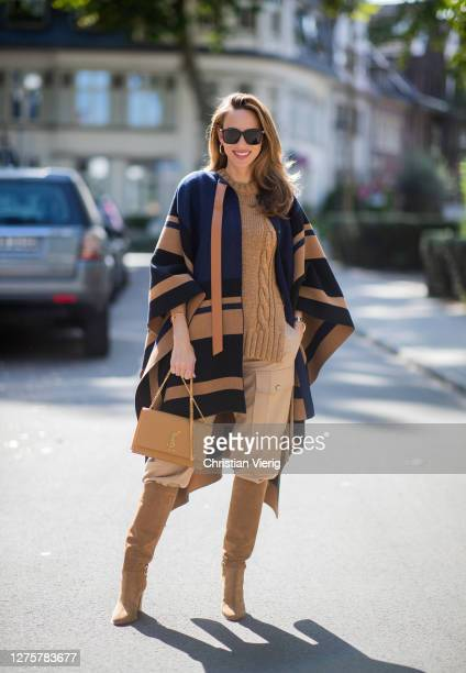 Alexandra Lapp is seen wearing Chloé striped wool cape Chloé chunkyknit sleeveless jumper in camel Chloé linen cargo pants in beige SAINT LAURENT...