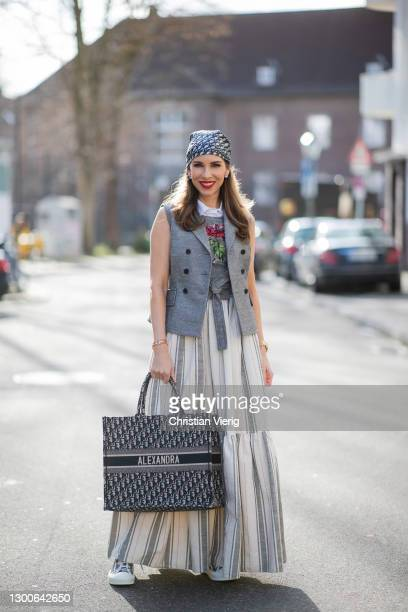 Alexandra Lapp is seen wearing CHRISTIAN DIOR Cruise collection 2021, vest in grey, CHRISTIAN DIOR wrap top with flower print in grey, CHRISTIAN DIOR...