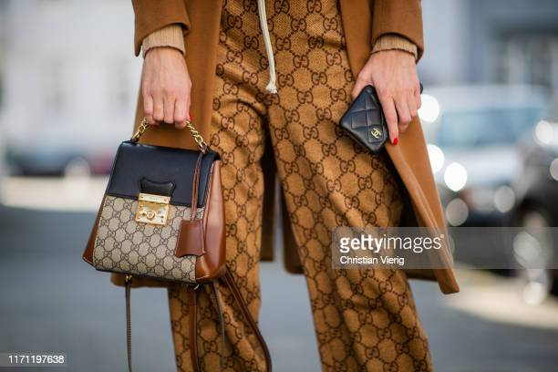 Alexandra Lapp is seen wearing Gucci GG jogging pants toffee colored Loro Piana cashmere coat sand colored Parenti's sweater white Gucci logo TShirt...