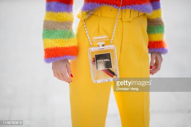 Alexandra Lapp is seen wearing high-waist yellow pants from Zara, multicolored hand knit sweater from Ganni, and the Chanel No.5 Perfume Bottle...