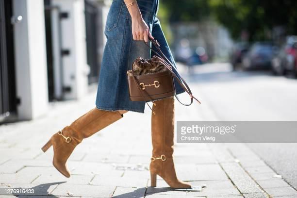 Alexandra Lapp is seen wearing Isabel Marant cap sleeve knitted jumper Celine denim shorts Gucci small 1955 Horsebit bucket bag in brown Chloe Emma...