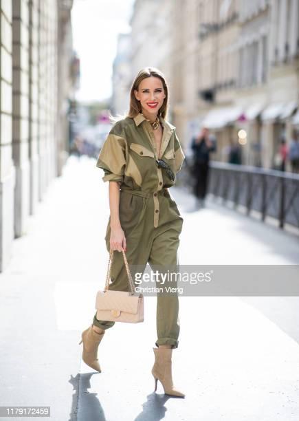 Alexandra Lapp is seen wearing Isabel Marant Etoile Guan jumpsuit, beige vintage Chanel flap bag, beige Zara suede boots during Paris Fashion Week...