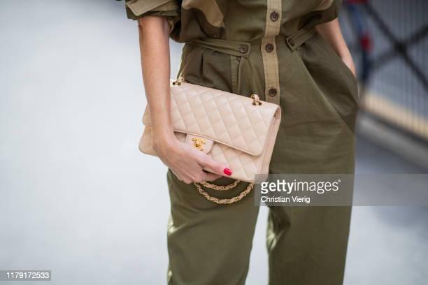Alexandra Lapp is seen wearing Isabel Marant Etoile Guan jumpsuit, beige vintage Chanel flap bag during Paris Fashion Week Womenswear Spring Summer...