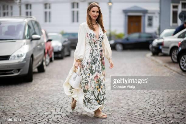 Alexandra Lapp is seen wearing Jardin Champêtre dress in sanded silk, Dior Granville Espadrille with laces in beige, Dior jardin necklace, J'Adior...