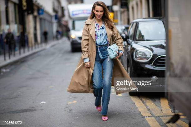 Alexandra Lapp is seen wearing Jeans Jane Flare from Celine, double breasted trench coat from Valentino, Stella McCartney blouse, Bottega Veneta...