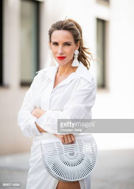 Alexandra Lapp is seen wearing La robe Amadora dress in white by Jacquemus white Inez leather sandals by Saint Laurent white Gaia's Ark bag by Cult...