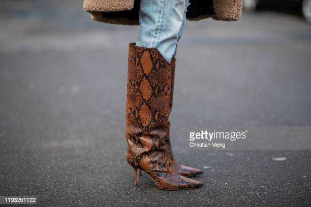 Alexandra Lapp is seen wearing light blue ripped denim jeans Celine brown Jimmy Choo boots with snake print on December 10 2019 in Duesseldorf Germany