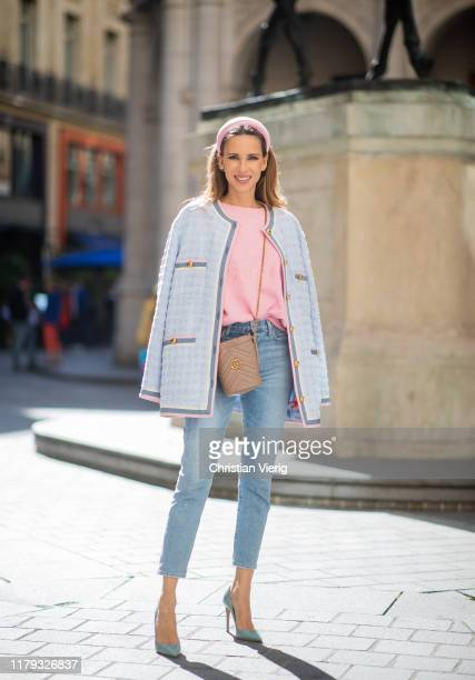 Alexandra Lapp is seen wearing pink Gucci Tennis sweater, light blue tweed jacket from Gucci, pink silk headband from Prada, light blue...