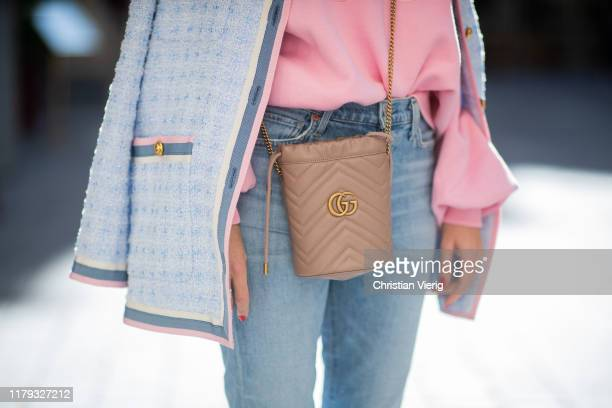 Alexandra Lapp is seen wearing pink Gucci Tennis sweater, light blue tweed jacket from Gucci, GG Marmont Mini-Bucket bag in nude, Citizens of...