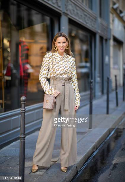 Alexandra Lapp is seen wearing printed Gucci blouse with oversized collar, beige Burberry paperbag pants with a high waist and broad belt detail, GG...
