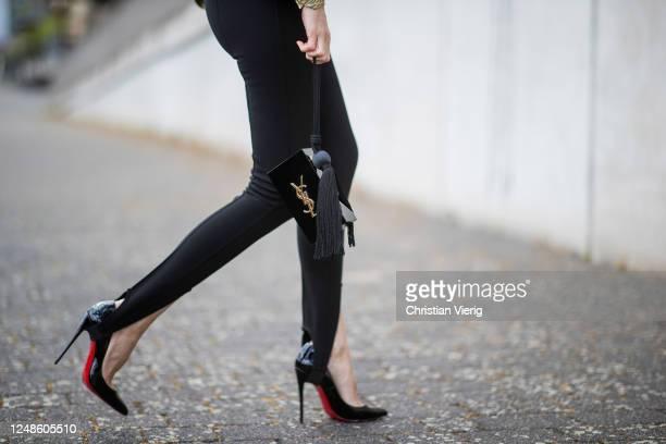 Alexandra Lapp is seen wearing Saint Laurent stretch knit stirrup leggings in black black So Kate pumps from Christian Louboutin Saint Laurent...