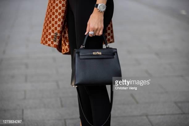 Alexandra Lapp is seen wearing Saint Laurent stretch knit stirrup leggings in black, Gucci jacquard monogram blazer, Tom Ford vintage silk top in...