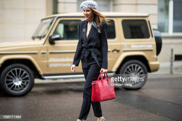 Alexandra Lapp is seen wearing the black IRO Delicate jumpsuit styled with a Chanel logo brooch black and white Chanel tweed beret of the la pause...