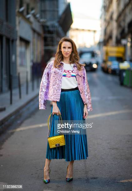 Alexandra Lapp is seen wearing the crinkled Alby laminated jacket from Sies Marjan a pleated metallic skirt from ROQA in turquoise a white logo print...