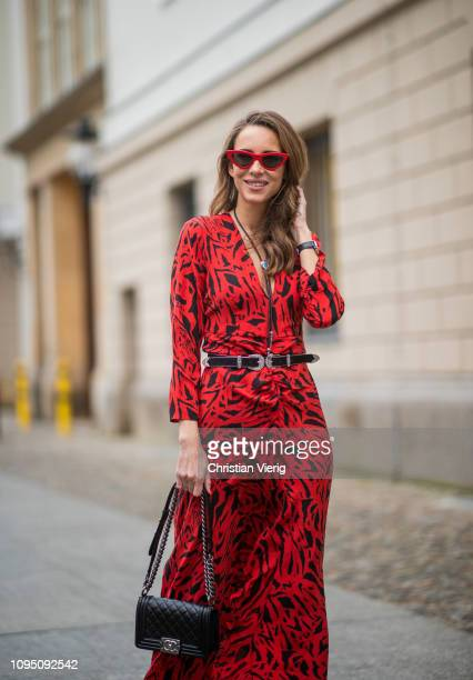 Alexandra Lapp is seen wearing the long Adriana animal print dress from Rixo a black boy bag from Chanel a silver buckled HM cowboy belt a western...