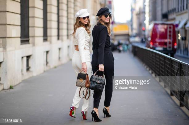 Alexandra Lapp is seen wearing the white Celia overall in a smoking optic with a cutout back from bash a white baker boy cap from Chanel the patent...