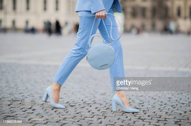 Alexandra Lapp is seen wearing total look Marc Cain: blue blazer, pants worn as a suit, round bag, blue shoes during the Berlin Fashion Week...