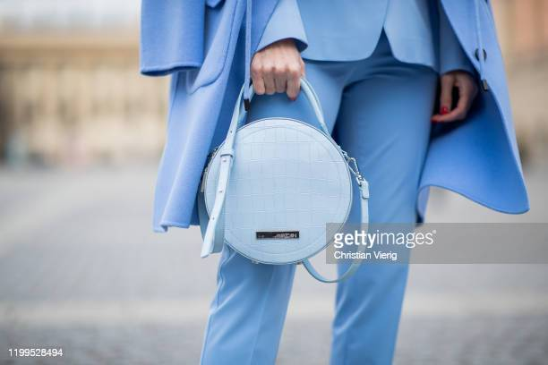 Alexandra Lapp is seen wearing total look Marc Cain blue blazer pants worn as a suit round bag wool coat during the Berlin Fashion Week Autumn/Winter...
