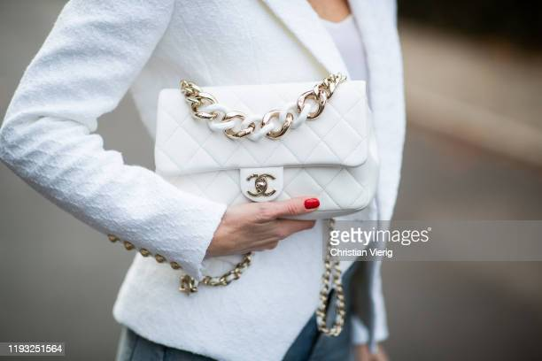 Alexandra Lapp is seen wearing white double-breasted Balmain blazer with golden buttons, silk top, white Chanel bag on December 10, 2019 in...