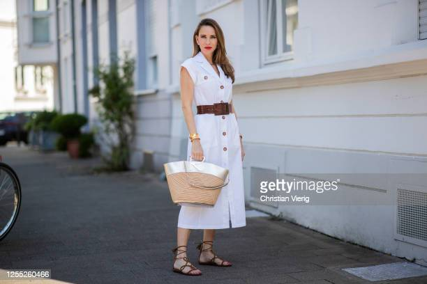 Alexandra Lapp is seen wearing white dress Riani brown waist belt from Max Mara Viv a la plage bag from Roger Vivier Aquazzura Gitana sandals in...