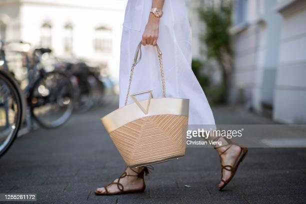 Alexandra Lapp is seen wearing white dress Riani brown waist belt from Max Mara Viv a la plage bag from Roger Vivier Aquazzura Gitana sandals in...