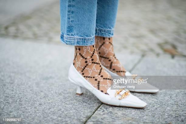 Alexandra Lapp is seen wearing white shoes Bottega Veneta, denim jeans Adriano Goldschmied, Gucci socks during the Berlin Fashion Week Autumn/Winter...