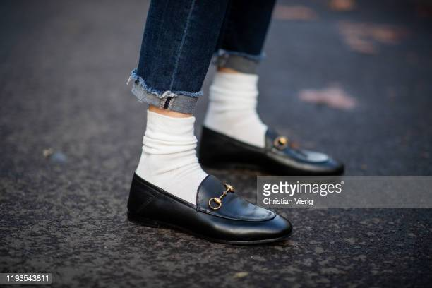 Alexandra Lapp is seen wearing white socks, black Gucci loafers Brixton Collapsible on December 11, 2019 in Duesseldorf, Germany.