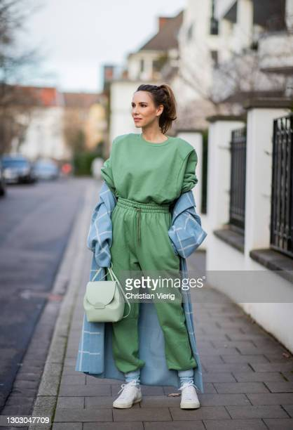Alexandra Lapp is seen wearing ZARA oversized checked coat in light blue, THE FRANKIE SHOP Vanessa sweatshirt and track pants, MANGO knitted socks in...