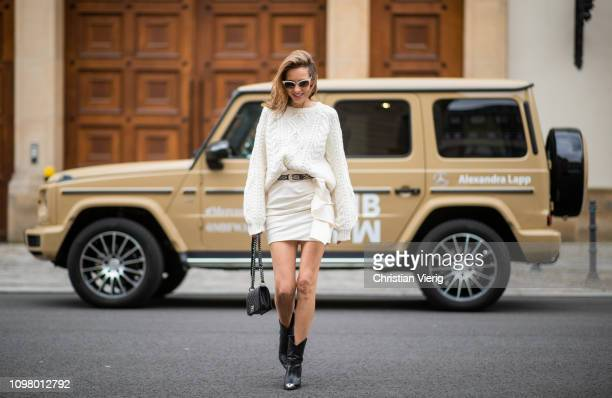 Alexandra Lapp is seen with Mercedes G500 wearing offwhite cable knit sweater from Maje Isabel Marant ruffled skirt Nefly in offwhite embroided and...
