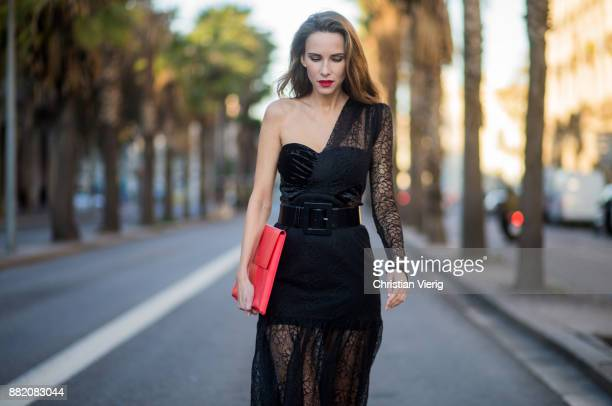 Alexandra Lapp wearing a black asymmetric shoulder dress with a delicate floral lace and a velvet fitted bustier from Three Floor, Pigalle Christian...