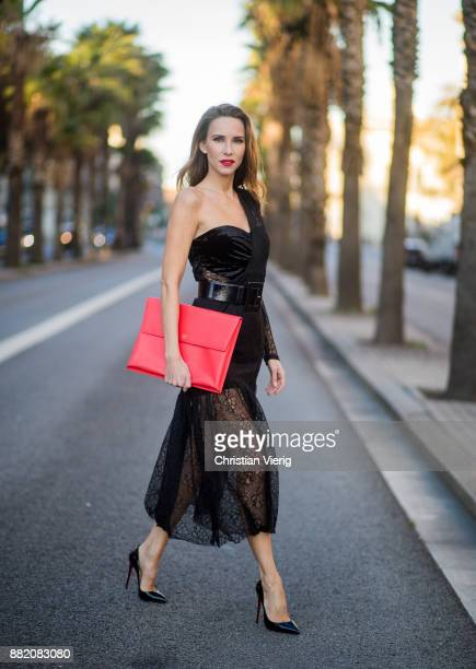 Alexandra Lapp wearing a black asymmetric shoulder dress with a delicate floral lace and a velvet fitted bustier from Three Floor Pigalle Christian...