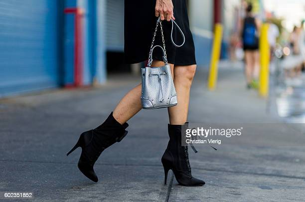 Alexandra Lapp wearing a black SET dress Balmain boots Furla bag outside Dion Lee on September 10 2016 in New York City
