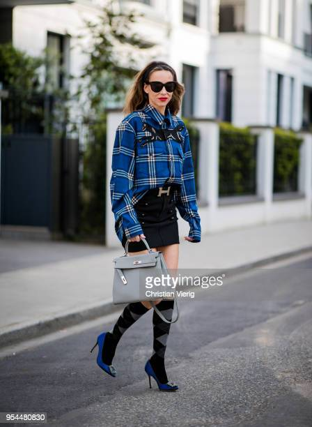 Alexandra Lapp wearing a blue embroidered check shirt by Gucci, a black wool skirt by Isabel Marant, blue Hangisi satin Manolo Blahnik pumps, grey...