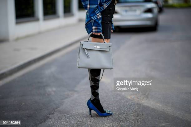 Alexandra Lapp wearing a blue embroidered check shirt by Gucci a black wool skirt by Isabel Marant blue Hangisi satin Manolo Blahnik pumps grey black...