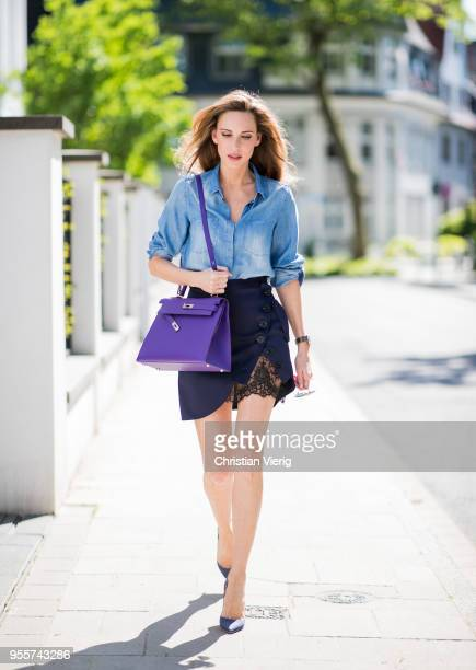 Alexandra Lapp wearing a blue satin skirt with lace by SelfPortrait a light blue denim shirt by HM a purple Kelly bag by Hermes Denim Jazz Calf So...