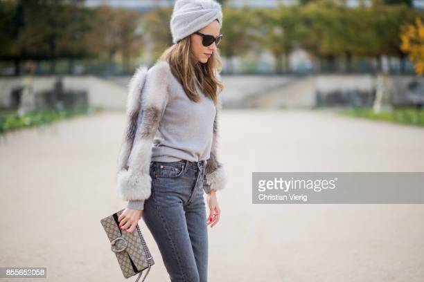 Alexandra Lapp wearing a cashmere turtleneck pullover with fur sleeves from Falconeri cashmere turban from Falconeri Levis 501 Skinny Fit jeans in...