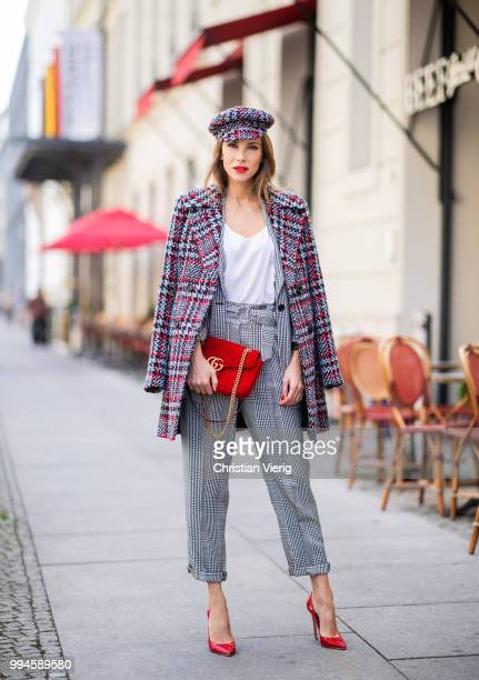 Alexandra Lapp wearing a checkered suit combination in black and white with a long blazer and high waist pants with an integrated belt both from...