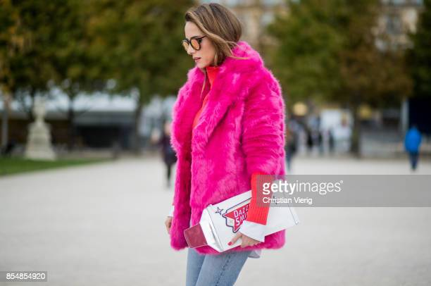 Alexandra Lapp wearing a fake fur jacket in pink from Jakke with a Faux Real statement on the back red cashmere jumper by Heartbreaker with golden...