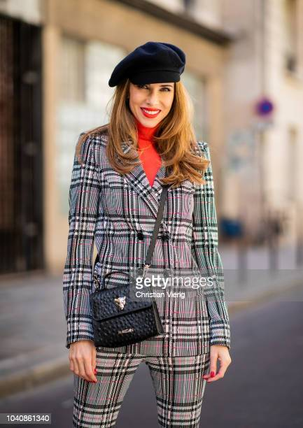Alexandra Lapp wearing a Glencheck suit with a long blazer and long cut pants from Marc Cain, an orange slim cut turtle neck pullover by Marc Cain,...