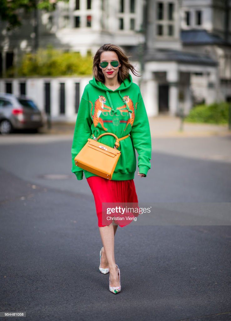 05ff363cfed Alexandra Lapp wearing a green tiger print Gucci logo hoodie